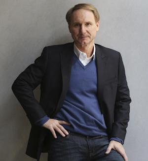 """In this Monday, May 13, 2013 photo, author Dan Brown poses for a portrait in New York. His new book, """"Inferno,"""" published by Doubleday releases on May 14, 2013.   (AP Photo/Seth Wenig)"""