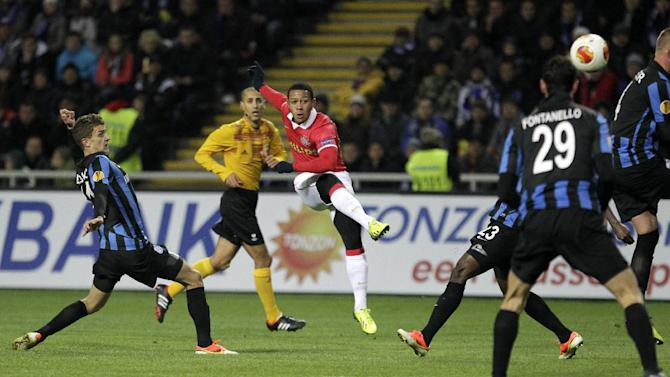 Netherlands PSV's Jrgen Locadia, centre, scores his goal during a Europa League Group B soccer match between FC Chornomorets and  PSV Eindhoven at the Chornomorets  stadium in Odessa , Ukraine, Thursday, Oct. 3, 2013
