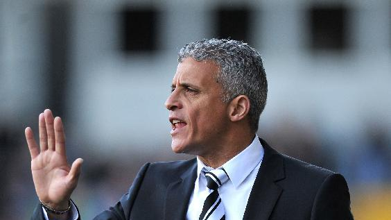 Notts County manager Keith Curle has shored up his defence with two new signings