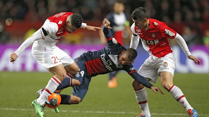 Paris Saint Germain's Marco Verratti of Italy, center, challenges for the ball with Monaco's Emmanuel Riviere of France, left, and Monaco's James Rodriguez of Colombia during their French League One soccer match, in Monaco stadium, Sunday, Feb. 9 , 2014