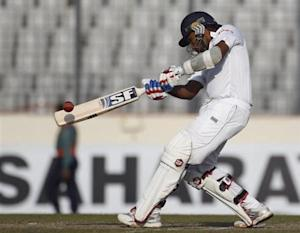 Sri Lanka's Mahela Jayawardene plays a shot against Bangladesh during the third day of their first test cricket match of the series in Dhaka January 29, 2014. REUTERS/Andrew Biraj
