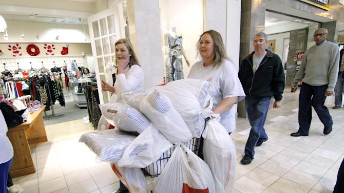 Laura Whitty of Harrisville, Miss., left, and Janice Barnett of Jayess, Miss. push a shopping cart through Northpark Mall in Ridgeland, Miss., Friday, Nov. 23, 2012.  Black Friday, the day when retailers traditionally turn a profit for the year, got a jump start this year as many stores opened just as families were finishing up Thanksgiving dinner. (AP Photo/Rogelio V. Solis)