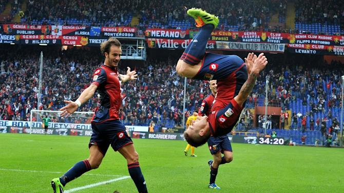 Genoa's Juraj Kucka, of Slovakia, right, celebrates past teammate Alberto Gilardino after scoring during a Serie A soccer match between Genoa and Verona, in Genoa's Luigi Ferraris Stadium, Italy, Sunday, Nov. 10, 2013