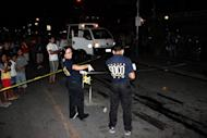 File picture shows Philippino police cordoning off a blast site after a unidentified man tossed an explosive device into a crowded tourist area in Iligan City, in sourthern island of Mindanao on May 5, 2012. Hooded gunmen shot dead an outspoken radio broadcaster in Iligan City, police said Friday, in a country branded as one of the most dangerous for journalists