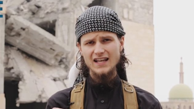 Canadian John Maguire, shown in this ISIS video, is reported to have died recently. (CBC)