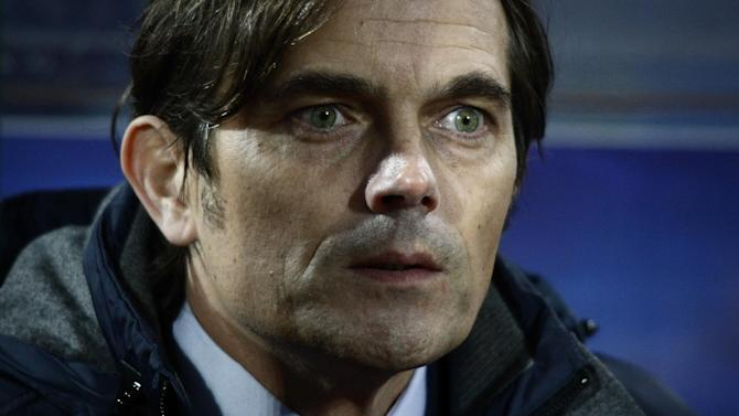 PSV Eindhoven's coach Phillip Cocu looks on during  Europa League group B soccer match between Ludogorets and PSV Eindhoven at the Vassil Levski Stadium in Sofia, Bulgaria, Thursday, Nov. 28, 2013. Ludogorets defeated PSV Eindhoven 2:0 (AP Photo)