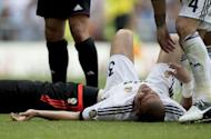 Real Madrid's Portuguese defender Pepe remains on the field with a gash in the head after being injured during the Spanish league football match between Real Madrid and Valencia on August 19, 2012 at the Santiago Bernabeu stadium in Madrid. Real Madrid coach Jose Mourinho said Wednesday he would rather lose the Spanish Super Cup to arch-rivals Barcelona if it meant his team could win La Liga
