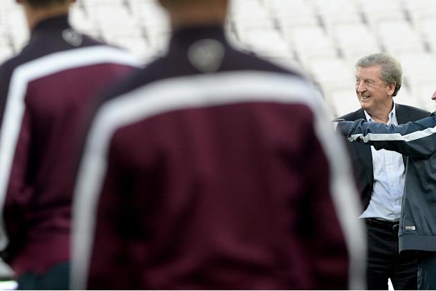 England manager Roy Hodgson smiles as he leads a training session ahead of Tuesday's international soccer match against Italy, at the Juventus Stadium, in Turin, Italy, Monday, March 30, 2015. (AP