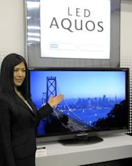 This file photo shows a Sharp's LCD TV display, LED AQUOS LC-60LX1, being presented at the company's Tokyo headquarters, in 2009. The century-old consumer electronics giant suffered a bloodletting this month with its Tokyo-traded shares diving to near 40-year lows after it reported huge quarterly losses and warned of more red ink to come