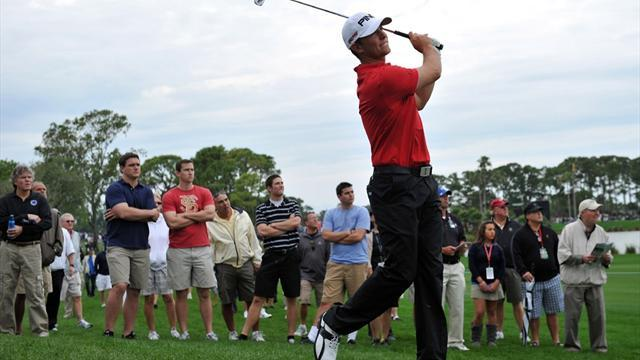 Golf - Guthrie in Honda driver's seat
