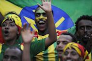 Ethiopia's supporters celebrate after Ethiopia's first goal during the 2014 FIFA World Cup qualifying football match Ethiopia vs South Africa on June 16, 2013 in Addis Ababa