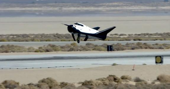 The private Dream Chaser space plane built by Sierra Nevada Corp. is seen landing with its left landing gear not deployed properly in this still from an Oct. 26, 2013 unmanned drop test at Edwards Air Force Base in California. The gear malfunct
