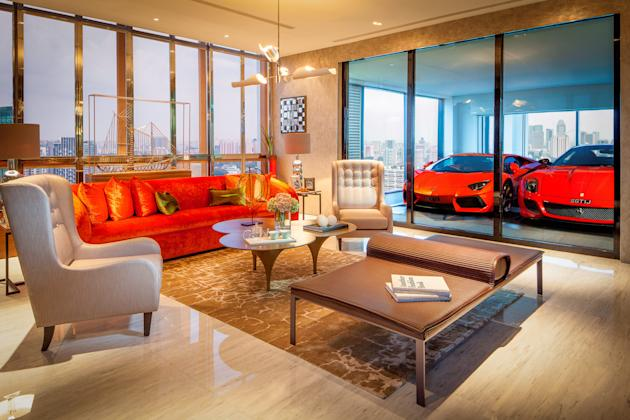 Supercar owners living in an exclusive high-rise apartment block in Singapore can now park their beloved motors next to their living rooms. They drive their motors into a lift at the base of the flats