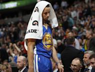 Golden State Warriors guard Stephen Curry heads to the bench with a towel over his head as the Warriors fell behind the Denver Nuggets in the second half of an NBA basketball game Monday, Feb. 13, 201, in Denver. The Nuggets won 132-110. (AP Photo/David Zalubowski)