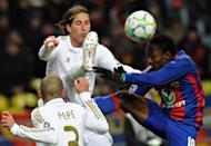 Pepe (L) and Sergio Ramos (C) of Real Madrid fight for the ball against Ahmed Musa (R) of CSKA Moscow during their round of 16, first leg match UEFA Champions League in Moscow. The match ended in a 1-1 draw