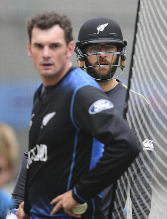 New Zealand's Dan Vettori, right, and New Zealand's Kyle Mills watch batting practice in the nets during a training at the Cricket World Cup in Melbourne, Australia, Saturday, March 28, 2015. New Zeal
