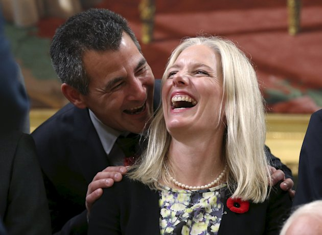 Canada's new Fisheries and Oceans, and Canadian Coastguard Minister Hunter Tootoo (L) shares a laugh with new Environment and Climate Change Minister Catherine McKenna during a group photo following a swearing-in ceremony at Rideau Hall in Ottawa, November 4, 2015. Liberal leader Justin Trudeau, 43, kicked off his majority government with some controversy with his decision to name an equal number of men and women to a slimmed-down Cabinet, the first time gender parity has been achieved in Canada's team of ministers. REUTERS/Chris Wattie