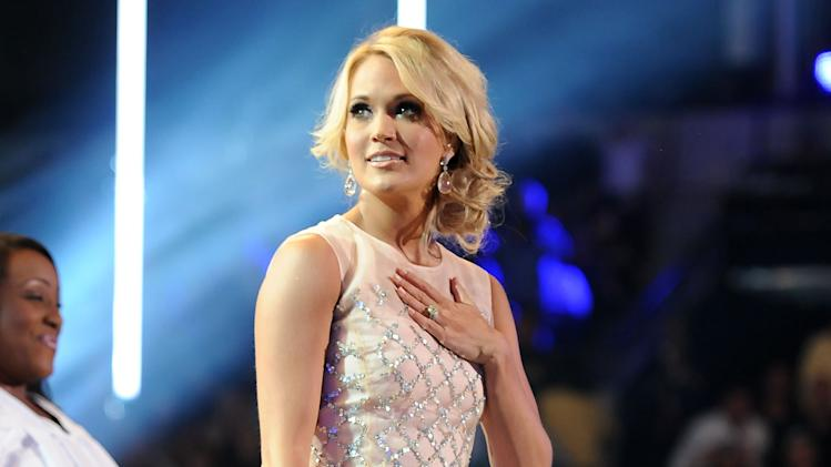 "FILE - This June 5, 2013 file photo shows Carrie Underwood at the 2013 CMT Music Awards at Bridgestone Arena in Nashville, Tenn. Underwood used Twitter to oppose the ""Ag Gag"" bill, that opponents claimed would have stopped investigation into animal abuse on farms, in Tennessee, reaching out directly to Gov. Bill Haslam with a boldly worded message saying if he signed it ""he needs to expect me at his front door."" (Photo by Frank Micelotta/Invision/AP, File)"
