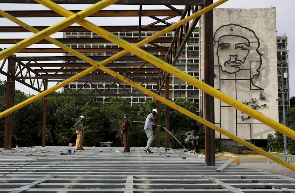 Workers construct a platform where the Pope Francis will celebrate mass on at the Revolution Square in Havana