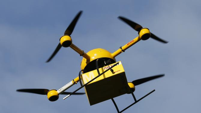 """A prototype """"parcelcopter"""" of German postal and logistics group Deutsche Post DHL flies in Bonn"""