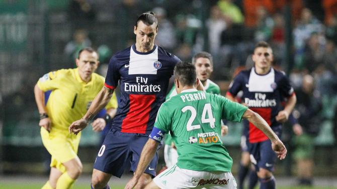 Ibrahimovic of Paris St-Germain challenges Perrin of St Etienne during their French Ligue 1 soccer match in Saint-Etienne