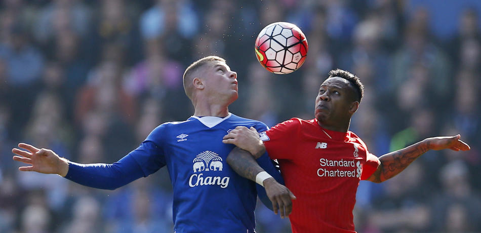 Everton's Ross Barkley in action with Liverpool's Nathaniel Clyne