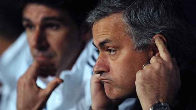 Real Madrid coach Jose Mourinho looks on during the defeat to Malaga