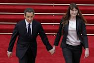 Former French president Nicolas Sarkozy and his wife Carla Bruni-Sarkozy leave the Elysee Palace in Paris. Socialist leader Francois Hollande has been sworn in as French president at a solemn ceremony overshadowed by the catastrophic debt crisis threatening to unravel the eurozone