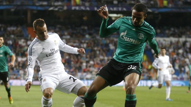 Real Madrid's Jese Rodriguez challenges Schalke's Joel Matip during their Champions League last 16 second leg soccer match at Santiago Bernabeu stadium in Madrid