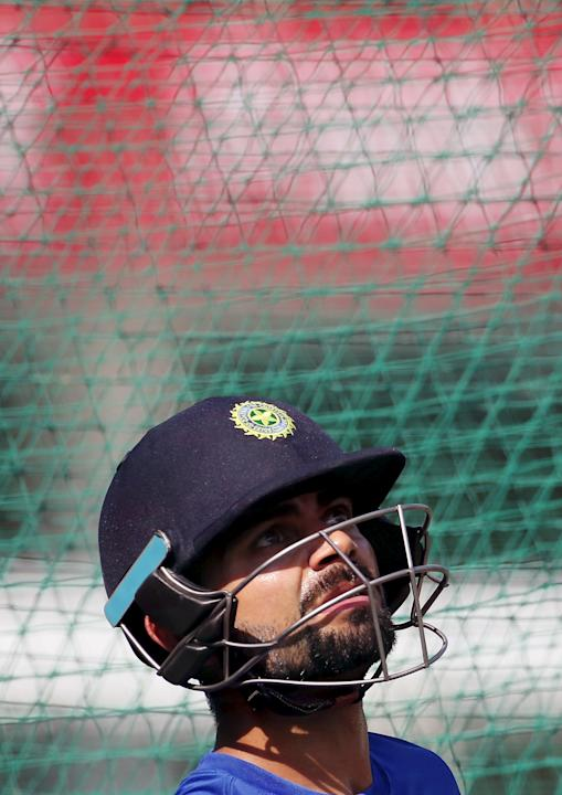 India's Kohli watches after hitting a shot in the nets during a practice session ahead of their first one-day international cricket match against South Africa in Kanpur