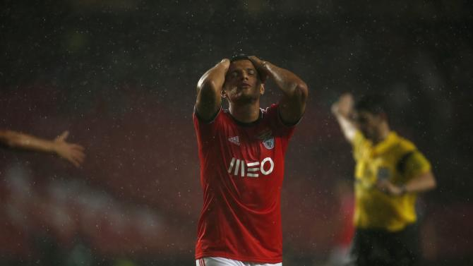 Benfica's Lima reacts after a missed scoring opportunity against Olympiakos during their Champions League soccer match at Luz stadium in Lisbon