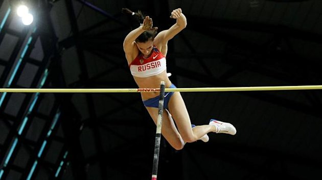 Yelena Isinbayeva of Russia competes during the women's pole vault event at the IAAF World Indoor Athletics Championships