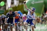 French Jonathan Hivert (R) celebrates as he crosses the finish line ahead of second-placed Portugal's Rui Costa (L) during the second stage of the Tour de Romandie cycling race, a 149,1 km race from Montbeliard to Moutier, in Moutier
