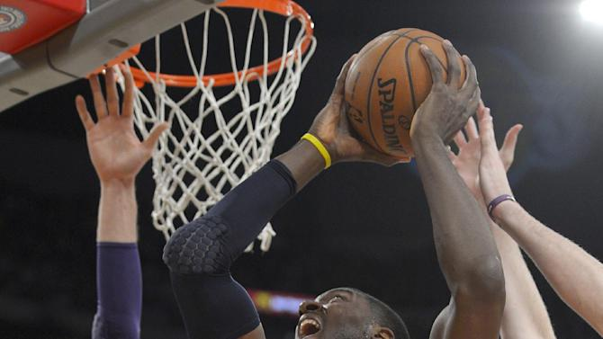 Indiana Pacers center Roy Hibbert, right, puts up a shot as Los Angeles Lakers center Pau Gasol, of Spain, defends during the first half of an NBA basketball game, Tuesday, Jan. 28, 2014, in Los Angeles. (AP Photo/Mark J. Terrill)