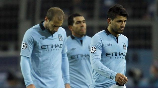 Manchester City players leave the pitch after their Champions League group D defeat to Borussia Dortmund (Reuters)