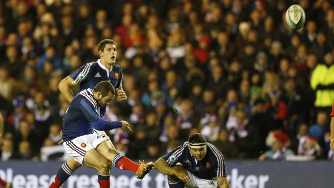 France's Jean-Marc Doussain kicks the winning penalty during their Six Nations rugby union match against Scotland at Murrayfield Stadium in Edinburgh