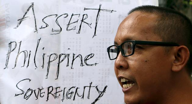 Member of Bayan Muna (Country First) Party List group speaks during a picket rally over territorial dispute with China in South China Sea, outside the Chinese Consulate in Makati