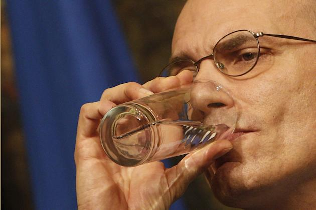 Italian Premier Enrico Letta drinks water during a press conference at Chigi Palace government office in Rome, Wednesday, Feb. 12, 2014. Letta announced he would lay out his strategy at an early eveni