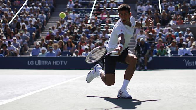 US Open - Djokovic coasts into third round as retirements mount up