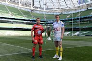 Clermont Auvergne's captain Aurelien Rougerie (R) and Toulon's captain Johny Wilkinson pose with the trophy at the Aviva Stadium in Dublin on May 17, 2013 on the eve of their European Cup rugby final rugby union match