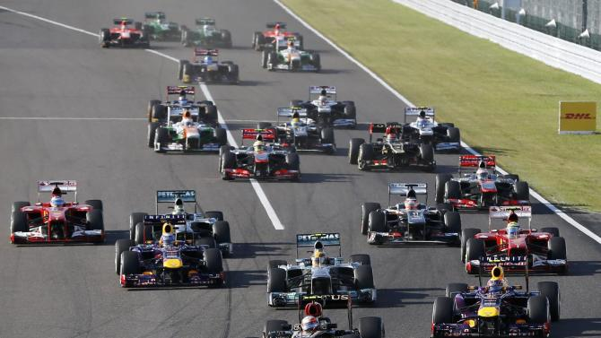 Lotus Formula One driver Grosjean of France leads during the Japanese F1 Grand Prix at the Suzuka circuit