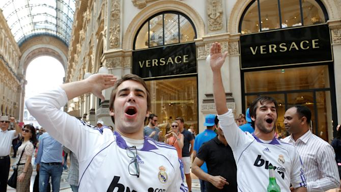 Real Madrid fans shout slogans before the Champions League Final between Real Madrid and Atletico Madrid in Milan