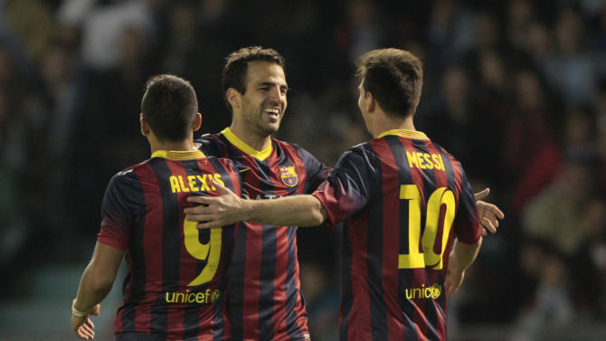 FC Barcelona's Cesc Fbregas, center, celebrates with Alexis Sanchez from Chile, left, and Lionel Messi from Argentina, right, after scoring the third goal against RC Celta during a Spanish La Liga soccer match at the Balaidos stadium in Vigo, Spain, Tuesday, Oct. 29, 2013