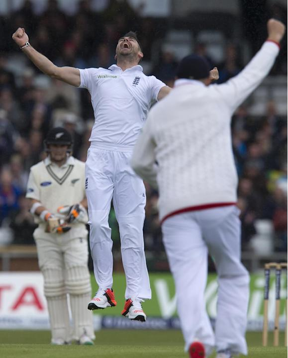 England's James Anderson, center, celebrates his 400th test wicket after taking the wicket of New Zealand's Martin Guptill, caught by Ian Bell for 0, on the first day of the second Test match