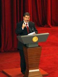 "President Mohamed Morsi delivers a speech at Cairo's University after being sworn-in at the Constitutional Court in Cairo. Morsi pointedly mentioned the ""elected parliament"" several times and said the army should resume its normal role"
