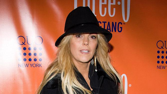 FILE - This Feb. 23, 2010 file photo shows Dina Lohan, mother of actress Lindsay Lohan, in New York. Lohan is facing a drunken driving charge in New York following a traffic stop on Long Island. State police say Dina Lohan was stopped on Nassau County's Northern State Parkway at 11 p.m. Thursday, Sept. 12, 2013, after troopers clocked her driving at 77 mph in a 55 mph zone. Police say she had a blood alcohol concentration at 0.20 percent. That's more than twice the legal limit in New York. Lohan was booked, issued tickets and then released. She's due in court Sept. 24. (AP Photo/Charles Sykes, File)
