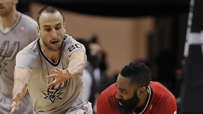 Houston Rockets guard James Harden, right, looks to pass around San Antonio Spurs guard Manu Ginobili, of Argentina, during the first half of an NBA basketball game Wednesday, Dec. 25, 2013, in San Antonio