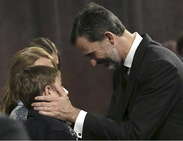 Spain's King Felipe gives condolences to relatives after a memorial service for the 150 victims of Germanwings flight 4U 9525 at Sagrada Familia Cathedral in Barcelona