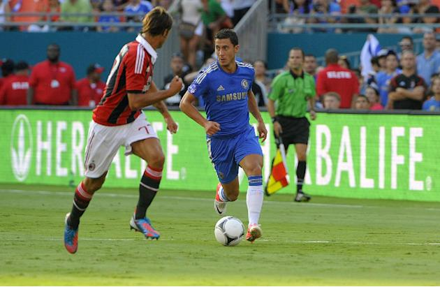 COMMERCIAL IMAGE - In this photograph taken by AP Images for Herbalife, Chelsea FC player Eden Hazard, right, controls the ball against  A.C. Milan player Luca Antonini at the Herbalife World Football