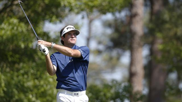 Masters Tournament - Bubba hangs on through calamities to share lead into finale